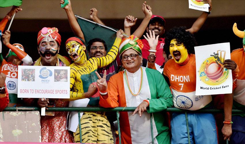 Indian fans cheer up before the start of the World T20 match between India and Bangladesh at Chinnaswamy Stadium in Bengaluru, Mar. 23. (Shailendra Bhojak | PTI)