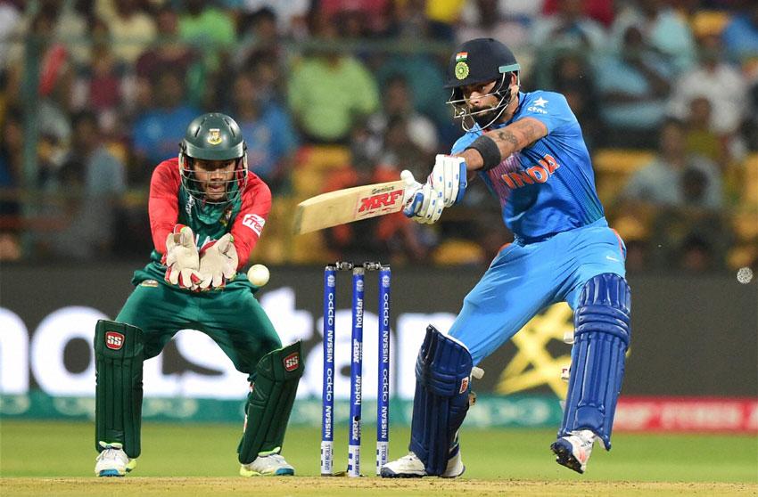 India's Virat Kohli plays a shot during the World T20 match against Bangladesh at Chinnaswamy Stadium in Bengaluru, Mar. 23. (Shailendra Bhojak | PTI)