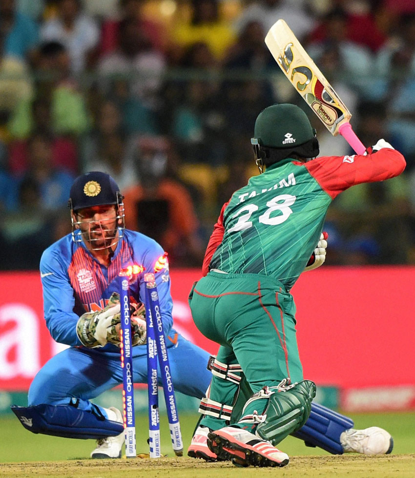 Bangladesh Tamim Iqbal stumped by Indian skipper and wicketkeeper M.S. Dhoni during the ICC World T20 match between India and Bangladesh at Chinnaswamy Stadium in Bengaluru, Mar. 23. (Shailendra Bhojak | PTI)