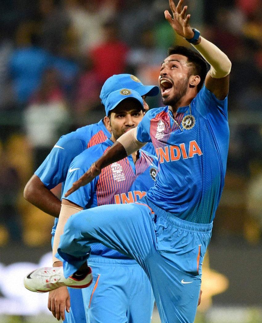 India's Hardik Pandya with teammates celebrate the win over Bangladesh during the ICC World T20 match between India and Bangladesh at Chinnaswamy Stadium in Bengaluru, Mar. 23. (Shailendra Bhojak | PTI)