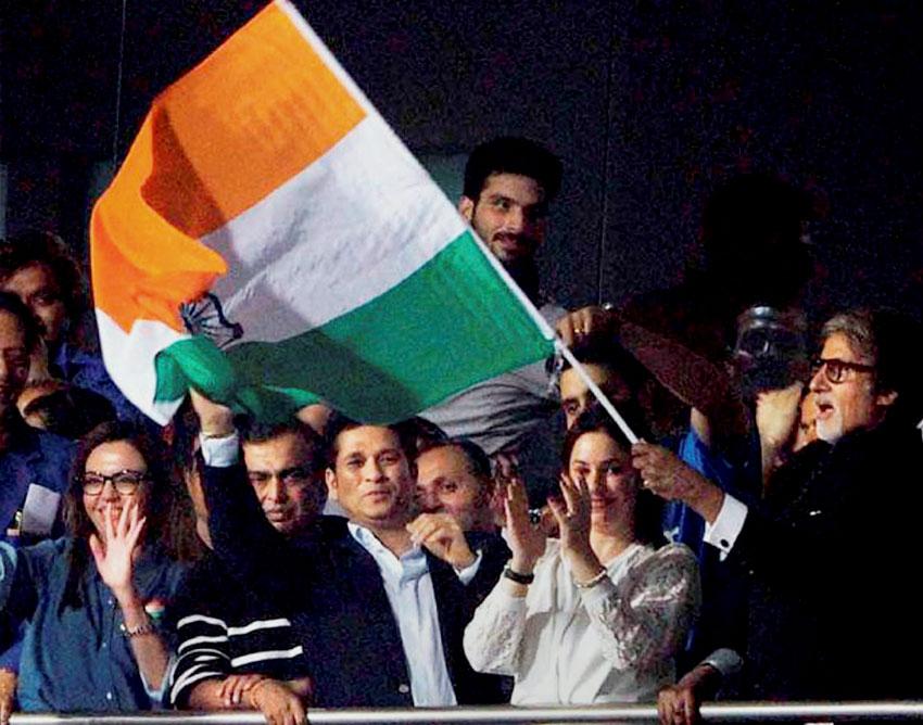 Amitabh Bachchan (r), Sachin Tendulkar with his wife Anjali, industrialist Mukesh Ambani and his wife Nita Ambani and others celebrate India's victory over Pakistan at Eden Gardens in Kolkata, Mar. 19. (Press Trust of India)
