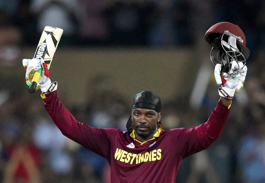 West Indies' Chris Gayle celebrates his century during a ICC #WT20 match against England at Wankhede Stadium in Mumbai, Mar. 16. (Mitesh Bhuvad | PTI)