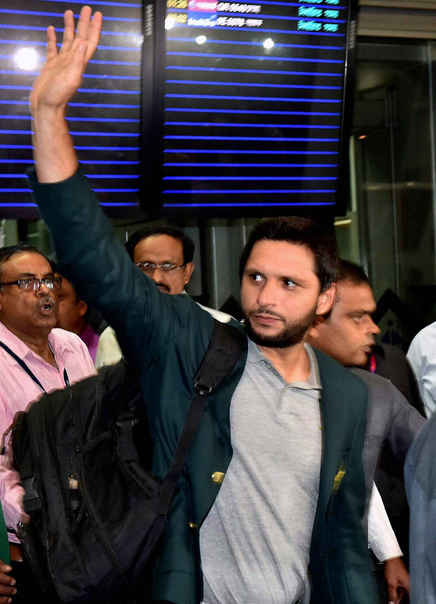 Pakistani cricket captain Shahid Afridi waves upon his team's arrival at NSCBI Airport for the upcoming T 20 World Cup in Kolkata, Mar. 12. (Ashok Bhaumik | PTI)