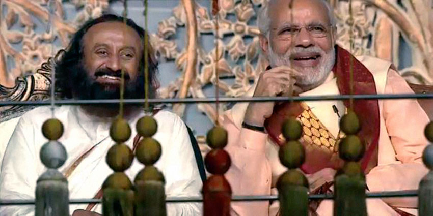 Prime Minister Narendra Modi with Art of Living founder Sri Sri Ravishankar during the opening day of the three-day long World Culture Festival on the banks of Yamuna River in New Delhi, Mar. 11. (Press Trust of India)