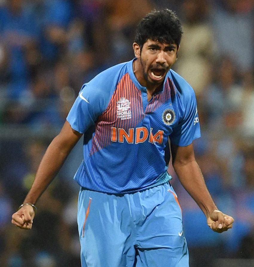 Indian bowler Jasprit Bumrah celebrates the wicket of West Indian batsman Chris Gayle during the ICC T20 World cup semi final match in Mumbai, Mar. 31. (Shashank Parade | PTI)
