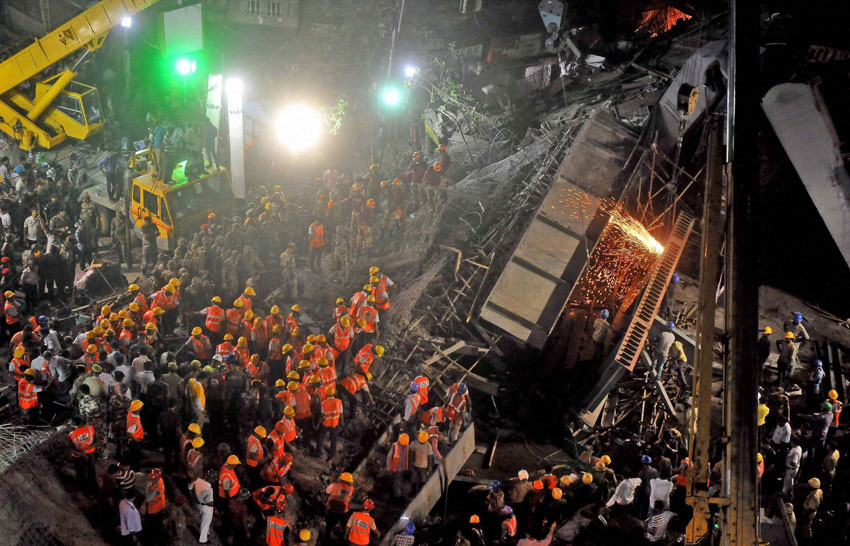 Rescue work in progress after an under-construction flyover collapsed in Vivekananda Road, in Kolkata, Mar. 31. (Press Trust of India)