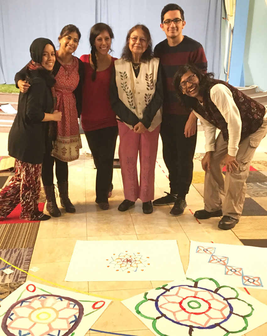 Mitali Perkins' mother, Madhusree Bose, in vest, surrounded by cast members, after teaching them how to paint 'alpanas.'