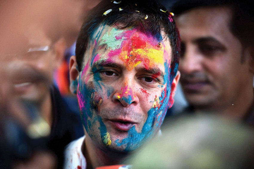 Congress vice president Rahul Gandhi speaks to media during Holi celebrations at All India Congress Committee headquarters in New Delhi, Mar. 24. (Vijay Verma | PTI)