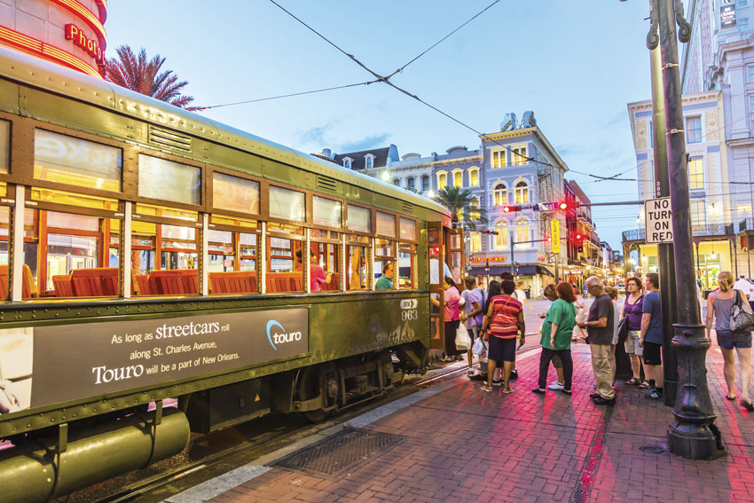 A trolley rolls along St. Charles Avenue in New Orleans.