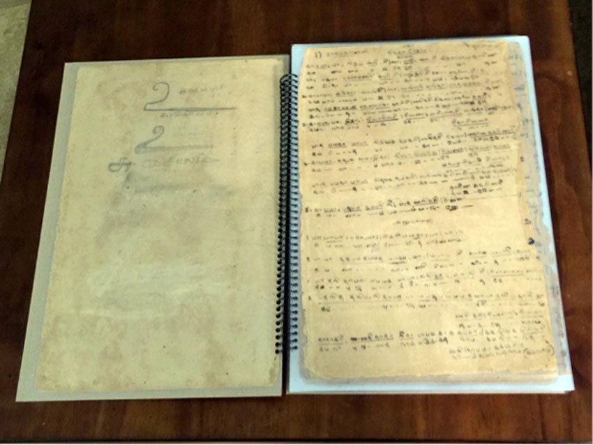 Restored 70-year old music notebook of the author's mom, made from stained poor quality paper during Word-War II, a vintage, antique possession.