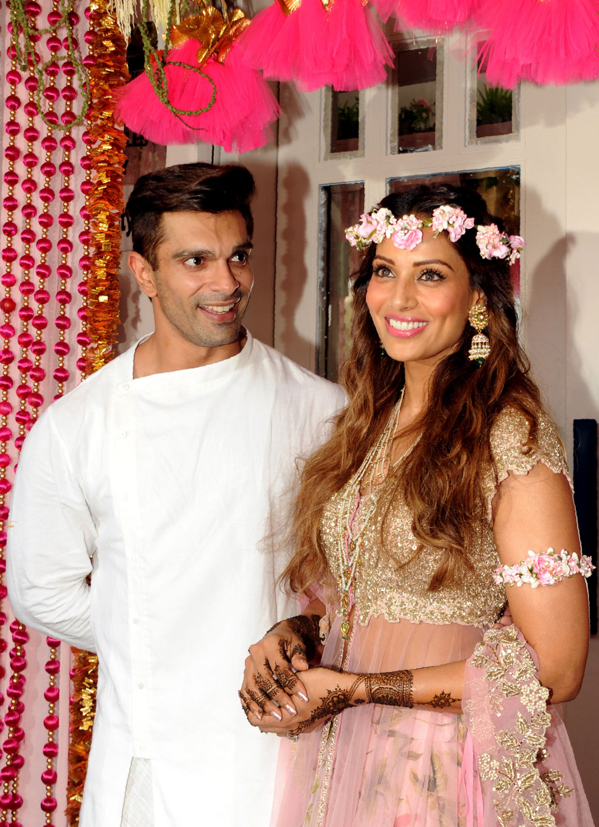 Karan Singh Grover (l) and Bipasha Basu pose for a photograph during their mehendi ceremony in Mumbai, April 29. (AFP | Getty Images)