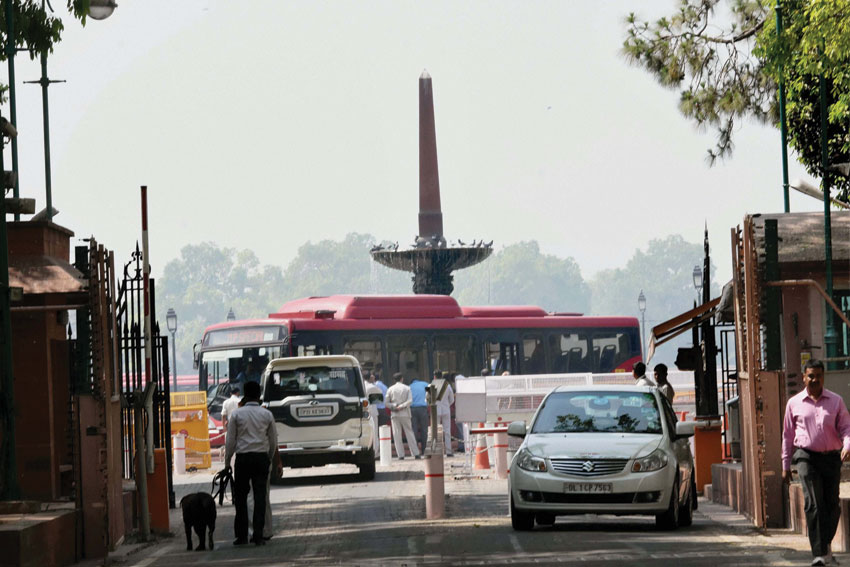 A MP Special DTC bus stationed at the main gate of Parliament in New Delhi, April 25. Six air-conditioned special buses were put in place by the Delhi government to ferry MPs to Parliament, as odd-even road rationing scheme was operational in the Indian capital. (Subhav Shukla | PTI)