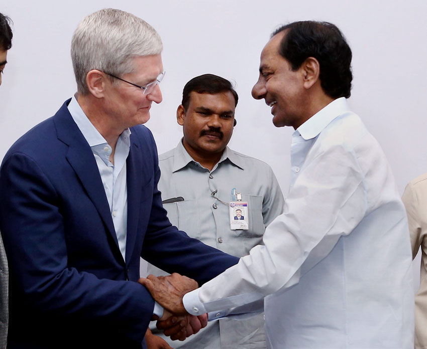 Apple CEO Tim Cook (l) shakes hands with Telangana CM K. Chandra Sekhar Rao after inaugurating Apple's development office in Hyderabad, May 19. (Press Trust of India)