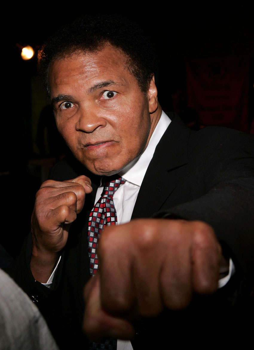 File photo of former boxer Muhammad Ali posing, as he attends the Grand Gala Hilton VIP reception held at the Muhammad Ali Center on May 5, 2006 in Louisville, Kentucky.  (Paul Hawthorne | Getty Images)
