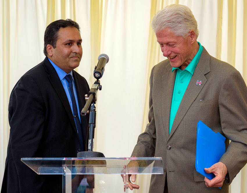 Tech executive Ajay Jain Bhutoria welcomes former President Bill Clinton to his home for a fundraiser event for Hillary Clinton, in Fremont, Calif., May 24. (Courtesy: Raj Nathwat | P.C. Sharma Photography)