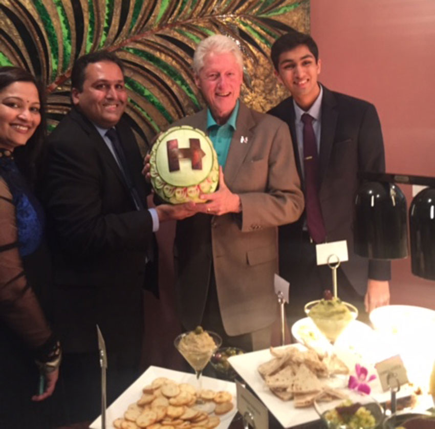 The Bhutorias, Vinita, Ajay and Raj with former President Bill Clinton at their home in Fremont, Calif., May 24. (Raj Nathwat)