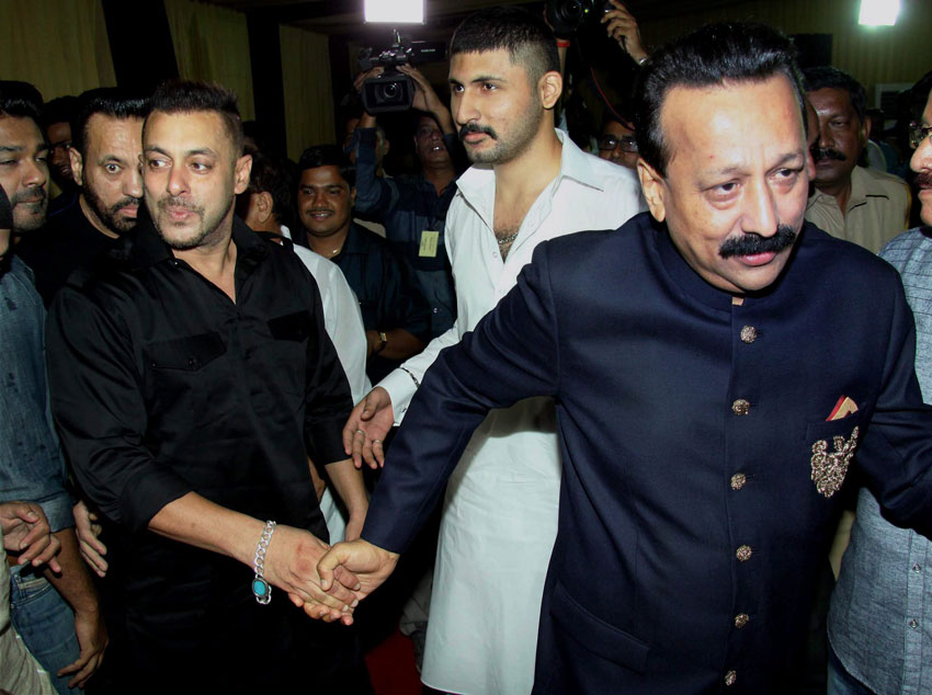 Salman Khan at an Iftar Party hosted by politician Baba Siddique (r) in Mumbai, June 20. (Press Trust of India)
