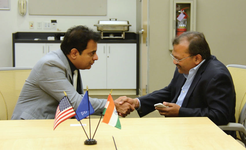 "Telangana's Information Technology Minister K. Taraka Rama Rao ""KTR"" (l) talks to Siliconeer co-founder Amar D. Gupta, at Applied Materials in Santa Clara, Calif., June 1. (Siliconeer)"