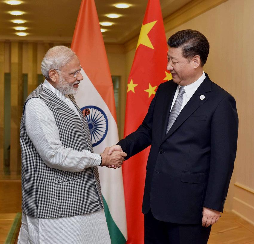 Prime Minister Narendra Modi shakes hands with Chinese President Xi Jinping during a meeting in Tashkent, June 23, on the sidelines of SCO Summit. (Press Trust of India)