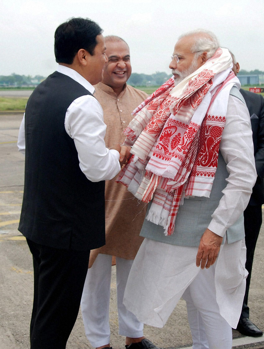 Prime Minister Narendra Modi is seen off by Assam Chief Minister Sarbananda Sonowal at the airport in Guwahati, May 28. (Press Trust of India)