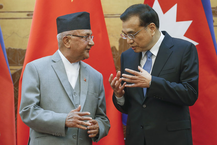 Chinese Premier Li Keqiang speaks with Nepalese Prime Minister K.P. Sharma Oli, (l), who was in China for a week-long visit aimed at deepening ties following months of frosty relations with India, during a signing ceremony at the Great Hall of the People in Beijing on Mar. 21. (Lintao Zhang | AFP | Getty Images)