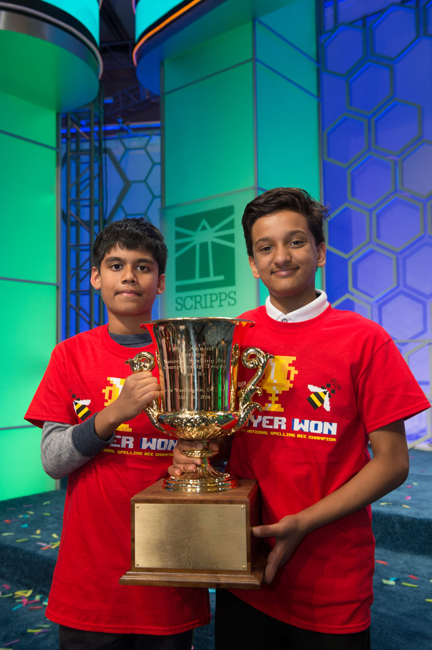 Nihar Saireddy Janga, 11, and Jairam Jagadeesh Hathwar, 13, (r), jointly lifted the trophy after being declared co-champions of the Scripps National Spelling Bee as the tense final ended in a tie for the third year in a row, in Washington, D.C., May 27. (Courtesy: Mark Bowen | Scripps National Spelling Bee)