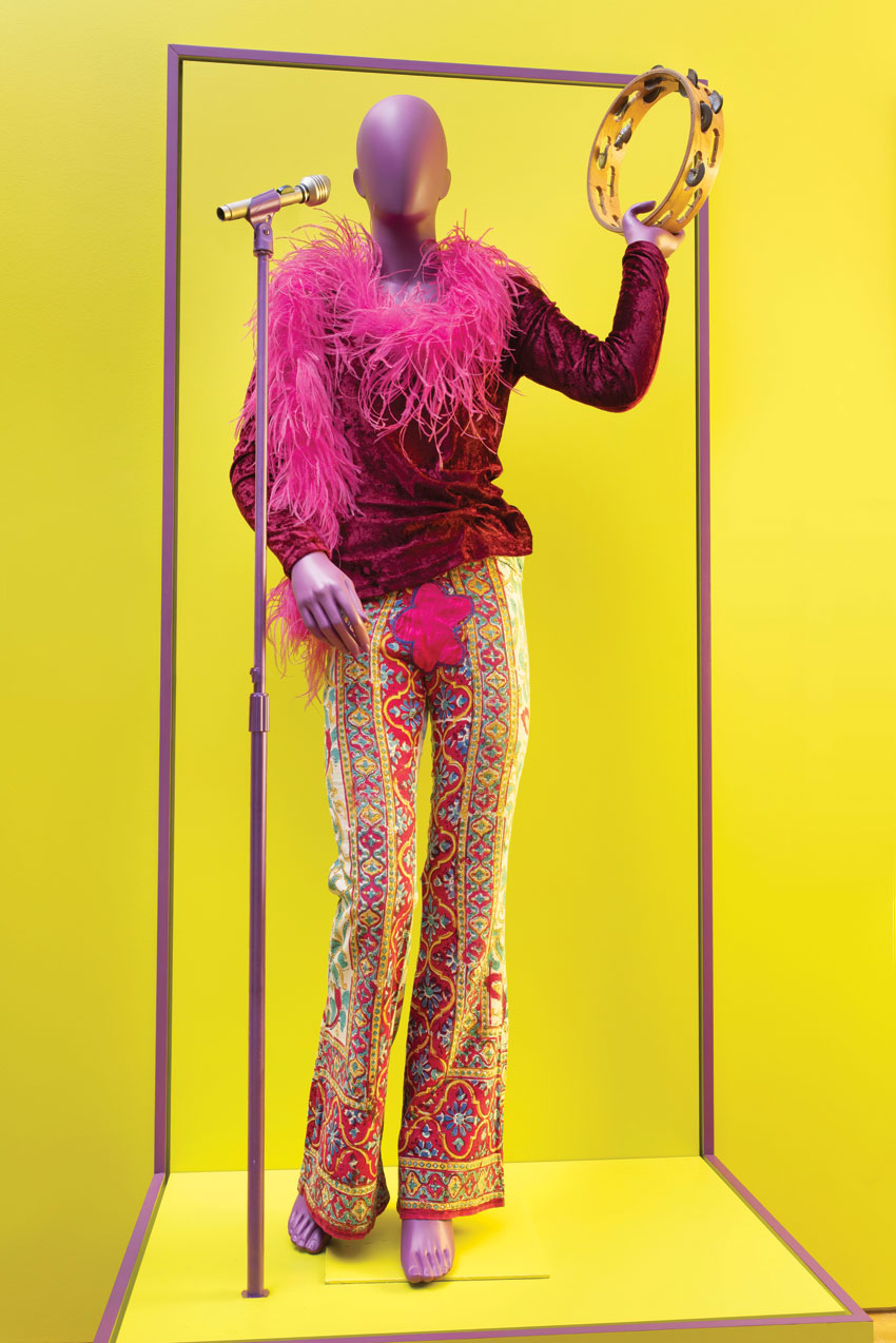 """Unknown, """"Janis Joplin's velvet top, bell-bottoms, feather boa, and leather bag,"""" circa 1968. Cotton velvet, linen, feathers, embroidered leather. Courtesy of EMP Museum, Seattle, WA. Photo by Robert Wedemeyer. """"Bill Graham and the Rock & Roll Revolution"""" is organized and circulated by the Skirball Cultural Center, Los Angeles, California. On view March 17–July 5, 2016 at The Contemporary Jewish Museum, San Francisco."""