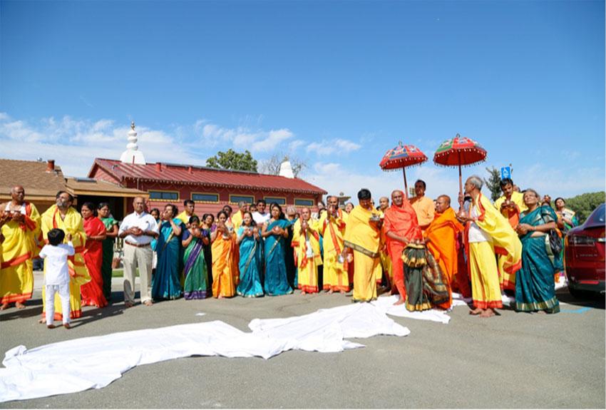 Narayananda Swami with devotees praying to Sun.
