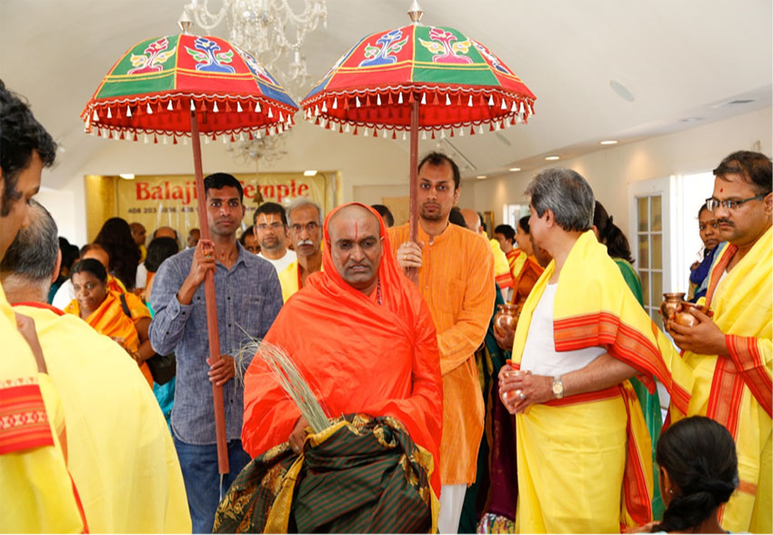 "Narayananda Swami carrying ""kalash"" with devotees."