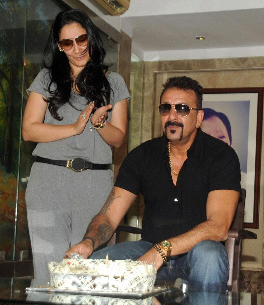 Sanjay Dutt with wife Manyata Dutt celebrates his 57th birthday at his residence in Mumbai, July 29. (Sunil Khandare | PTI)