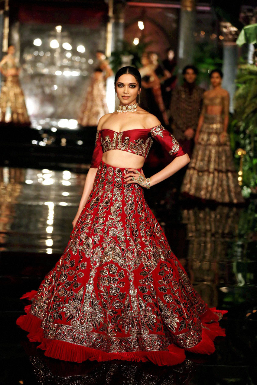 Deepika Padukone walks on the ramp in designer Manish Malhotra's creation at the opening of India Couture Week 2016, in New Delhi, July 20. (Press Trust of India)