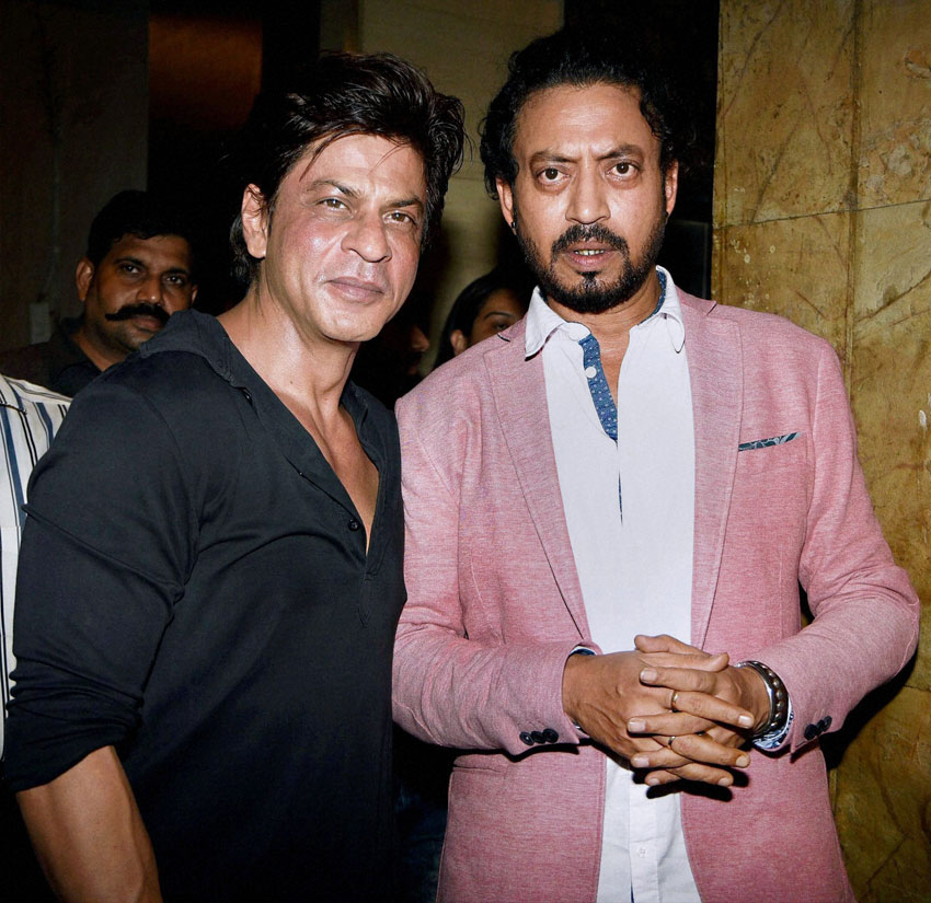 Shah Rukh Khan poses with Irrfan Khan during the screening of film 'Madaari,' in Mumbai, July 20. (Press Trust of India)