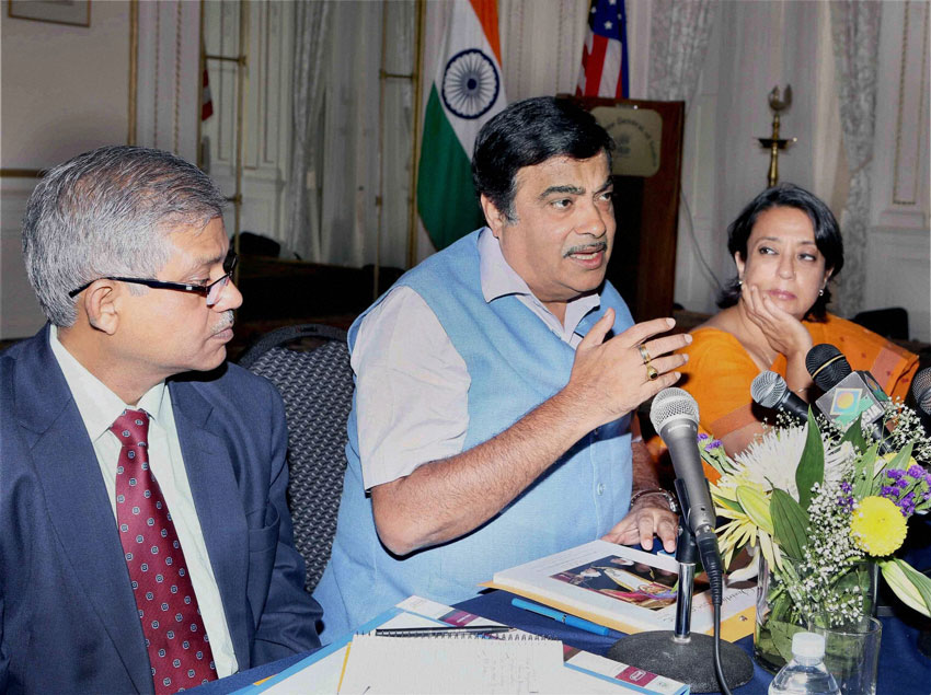 Indian Minister for Roads Transport Highways and Shipping, Nitin Gadkari, (c), flanked by Alok Srivastava, Addl Secretary Ministry of Shipping and Reeva Ganguly Das, Consul General of India in New York, at a press conference at the Indian Consulate, New York, July 13. (Press Trust of India)