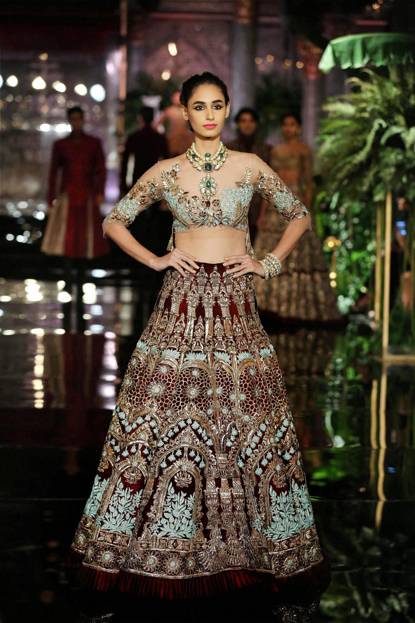 A model wearing Manish Malhotra walks the ramp on the opening day of India Couture Week 2016, in New Delhi. (Press Trust of India)