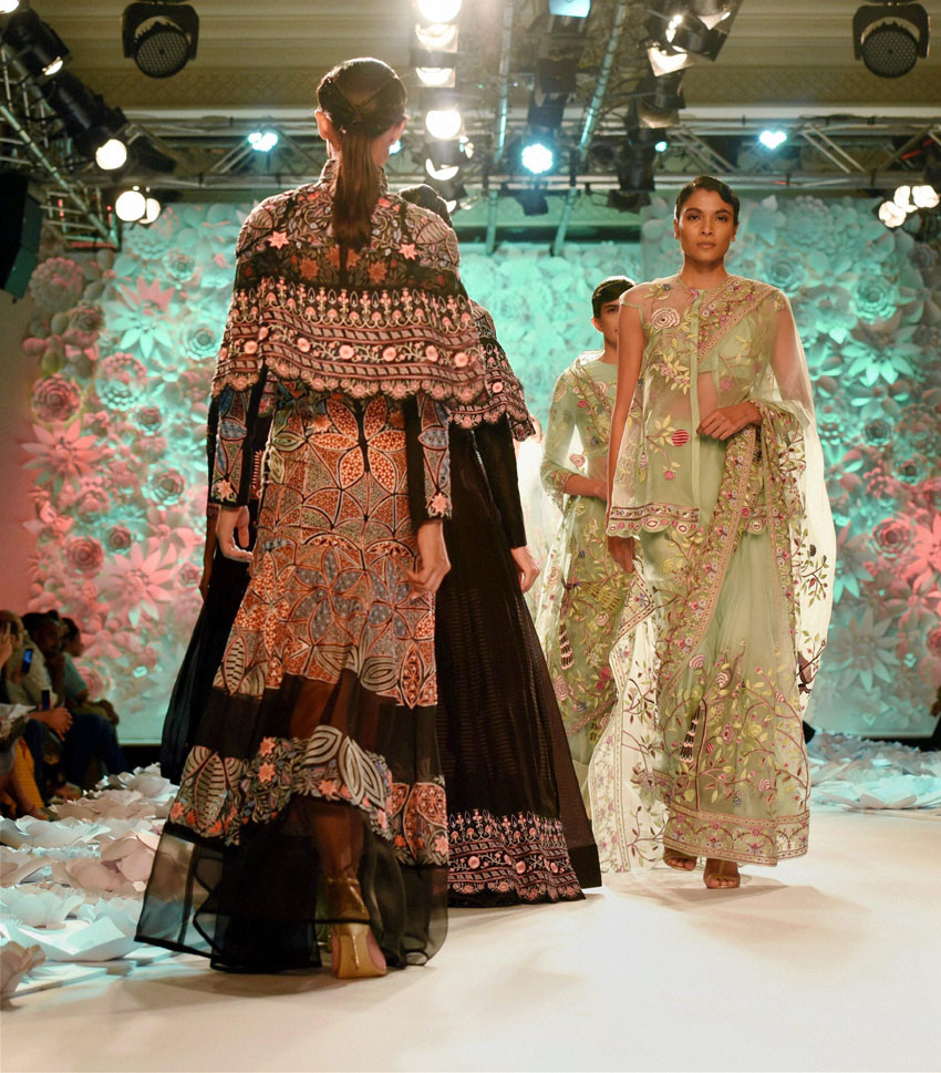 Models walk the ramp in clothes designed by Rahul Mishra during the India Couture Week 2016 in New Delhi. (Shirish Shete | PTI)