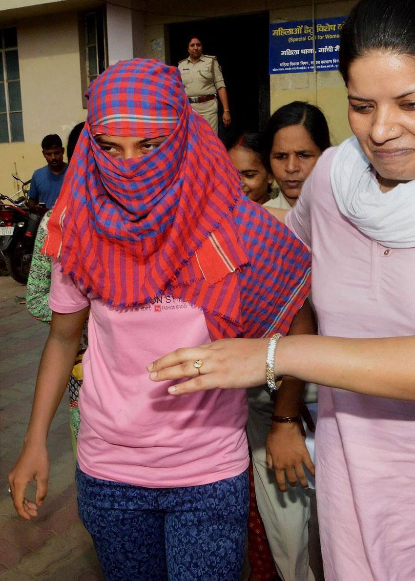 Bihar 12th class 'topper' accused Rubi Rai is taken to Civil Court in Patna, June 26. (Press Trust of India)