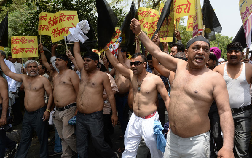 Indian taxi drivers and owners shout slogans against Delhi Chief Minister Arvind Kejriwal during a protest in New Delhi, May 4, against the banning of diesel cabs on the roads in the Indian capital. Hundreds of taxi drivers and owners took to the streets of New Delhi to protest a court order banning diesel cabs from plying the roads of the world's most polluted capital. The ban would impact some 27,000 diesel taxis registered in Delhi, including app-based cab operators Ola and Uber. (Prakash Singh | AFP | Getty Images)