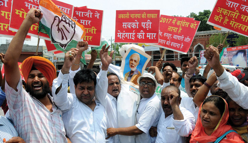 Congress leaders and workers protest against Centers' BJP government and its alliance partner in Punjab SAD (B) against rampant corruption, drug abuse etc. at Amritsar, June 27. (Press Trust of India)