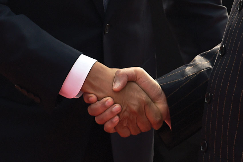 President Barack Obama (l) and Prime Minister Narendra Modi shake hands following a welcome ceremony at the Presidential Palace in New Delhi, Jan. 25, 2015. (Roberto Schmidt | AFP | Getty Images)