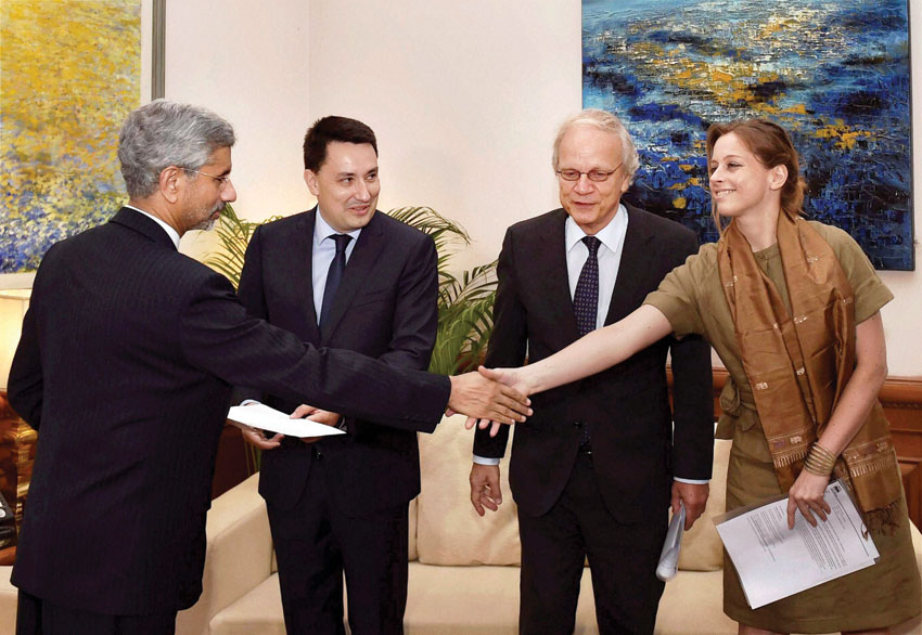 Foreign Secretary S. Jaishankar shakes hands with Luxembourg's Charge d Affaires, Laure Huberty after receiving Missile Technology Control Regime (MTCR) membership papers from France Ambassador-designate, Alexandre Ziegler, Netherlands Ambassador Alphonsus Stoelinga, in New Delhi, June 27. (Kamal Singh | PTI)
