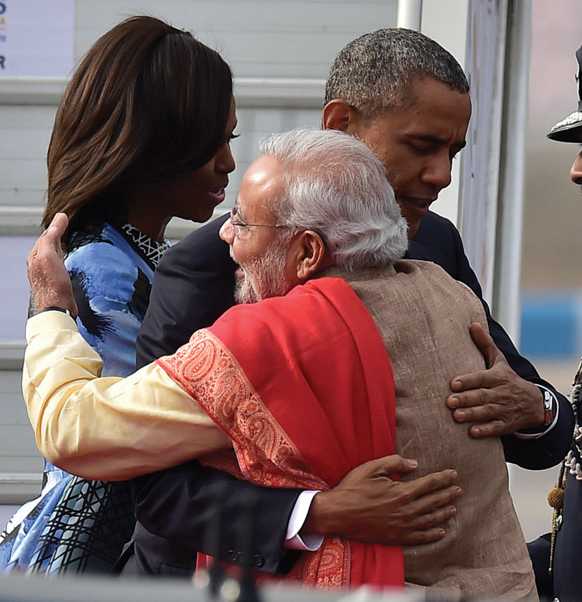 File photo of Prime Minister Narendra Modi as he hugs President Barack Obama and first lady Michelle Obama upon their arrival at Air Force station Palam, in New Delhi, Jan. 25, 2015. (Kamal Kishore PTI)