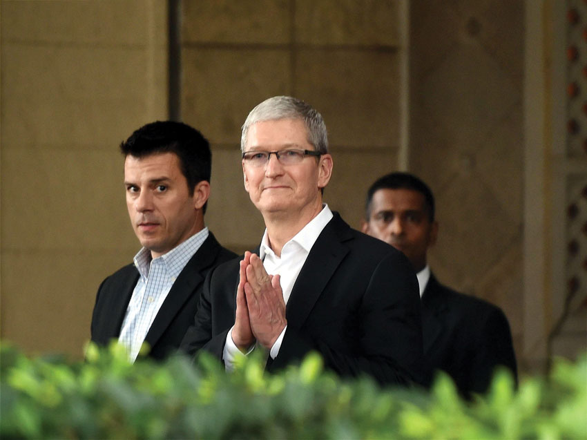 Apple CEO Tim Cook greets India on his maiden visit with a 'namaste' at the Taj Mahal Palace hotel in Mumbai, May 18. (Press Trust of India)