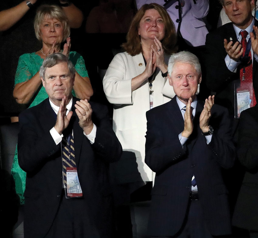 Former President Bill Clinton claps as he listens to President Barack Obama speak on the third day of the Democratic National Convention at the Wells Fargo Center, July 27, in Philadelphia, Pennsylvania. (Win McNamee | Getty Images)