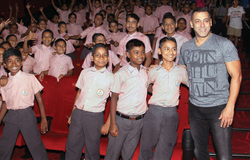 "Salman Khan with school children during a special show of his film ""Sultan"" in Mumbai, July 9. (Press Trust of India)"