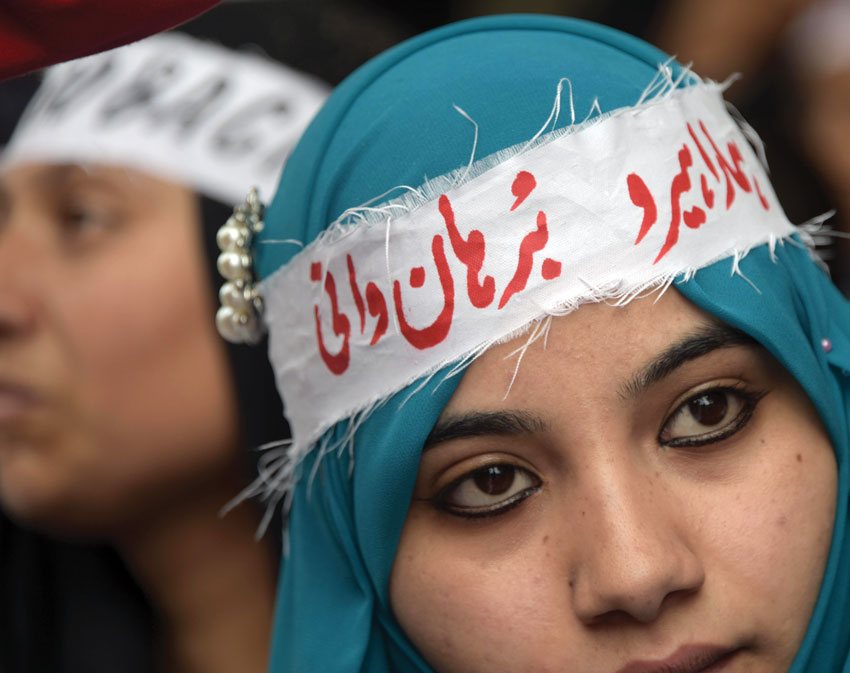 A Pakistani Kashmiri woman wears a headband that reads 'Our hero Burhan Wani,' – an Indian Kashmiri rebel – at an anti-India protest in Muzaffarabad, the capital of Pakistan-administered Kashmir, on July 27. (Sajjad Qayyum | AFP | Getty Images)