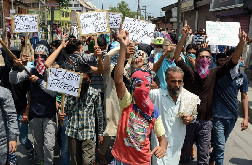 Protesters hold placards and shout slogans during a protest rally against the killing of civilians after the state authorities lifted 17 days curfew, in Srinagar, July 26. (Press Trust of India)