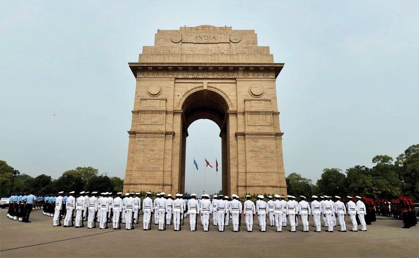 Soldiers paying homage to Kargil martyrs at 'Amar Jawan Jyoti' at India Gate on the occasion of 'Kargil Vijay Diwas'' in New Delhi, July 26. (Kamal Singh | PTI)