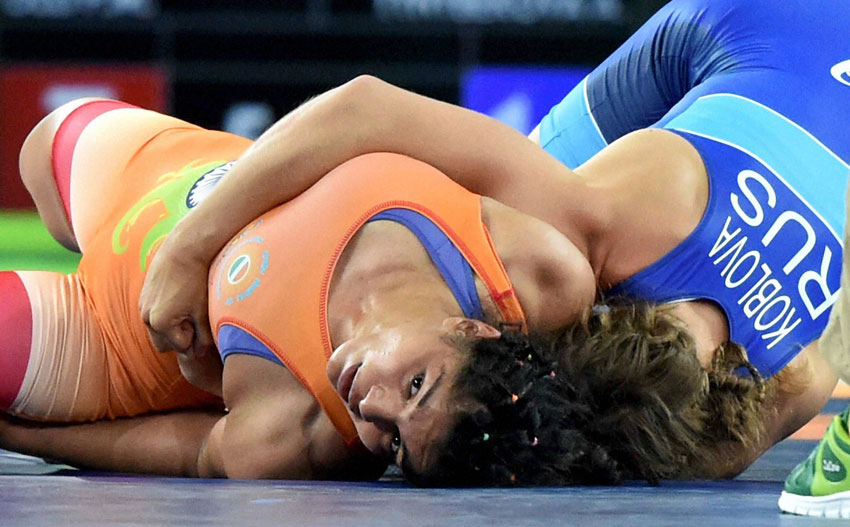 India's Sakshi Malik fights against Valeria Koblova of Russia during the quarterfinal match of Women's freestyle 58 kg at Summer Olympics 2016 in Rio de Janeiro, Brazil, Aug. 17. (Atul Yadav | PTI)