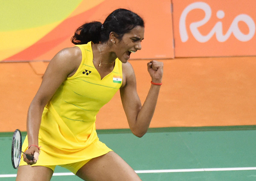 India's Sindhu Pusarla celebrates after defeating Japan's Nozomi Okuhara during a women's singles semifinal match at the 2016 Summer Olympics in Rio de Janeiro, Brazil, Aug. 18. (Atul Yadav | PTI)