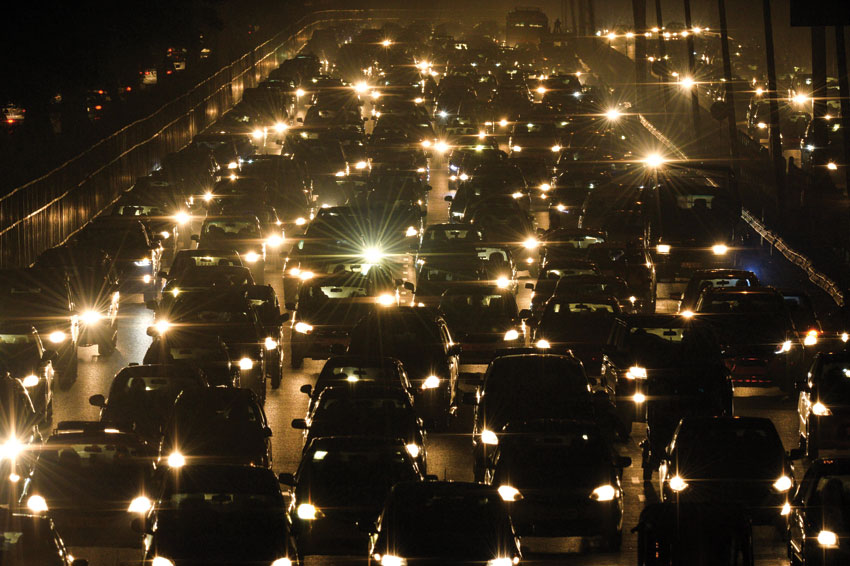 Commuters travel through a traffic jam on their way to New Delhi from Gurgaon. (Chandan Khanna | AFP | Getty Images)